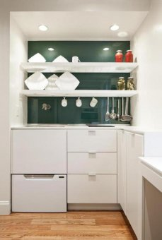 A slatted shelf unit hangs over the sink; it air-dries and stores dishes in the same spot.