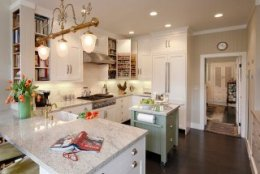 Cheerful kitchen with small island on wheels 24 Tiny Island Ideas for the Smart Modern Kitchen