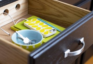 In-drawer charging station for phones and mobile devices.