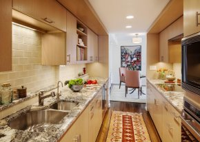 In this Cambridge kitchen, the fridge was placed below the counter.