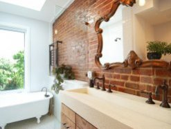 Satin-finish coated brick wall in the bathroom brings both textural beauty and a hint of glitter