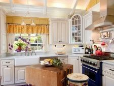 Vintage butcher block makes for a unique island in the small traditional kitchen [From: Debra Campbell Design]