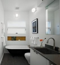 Wall sconces help in even lighting of the bathroom